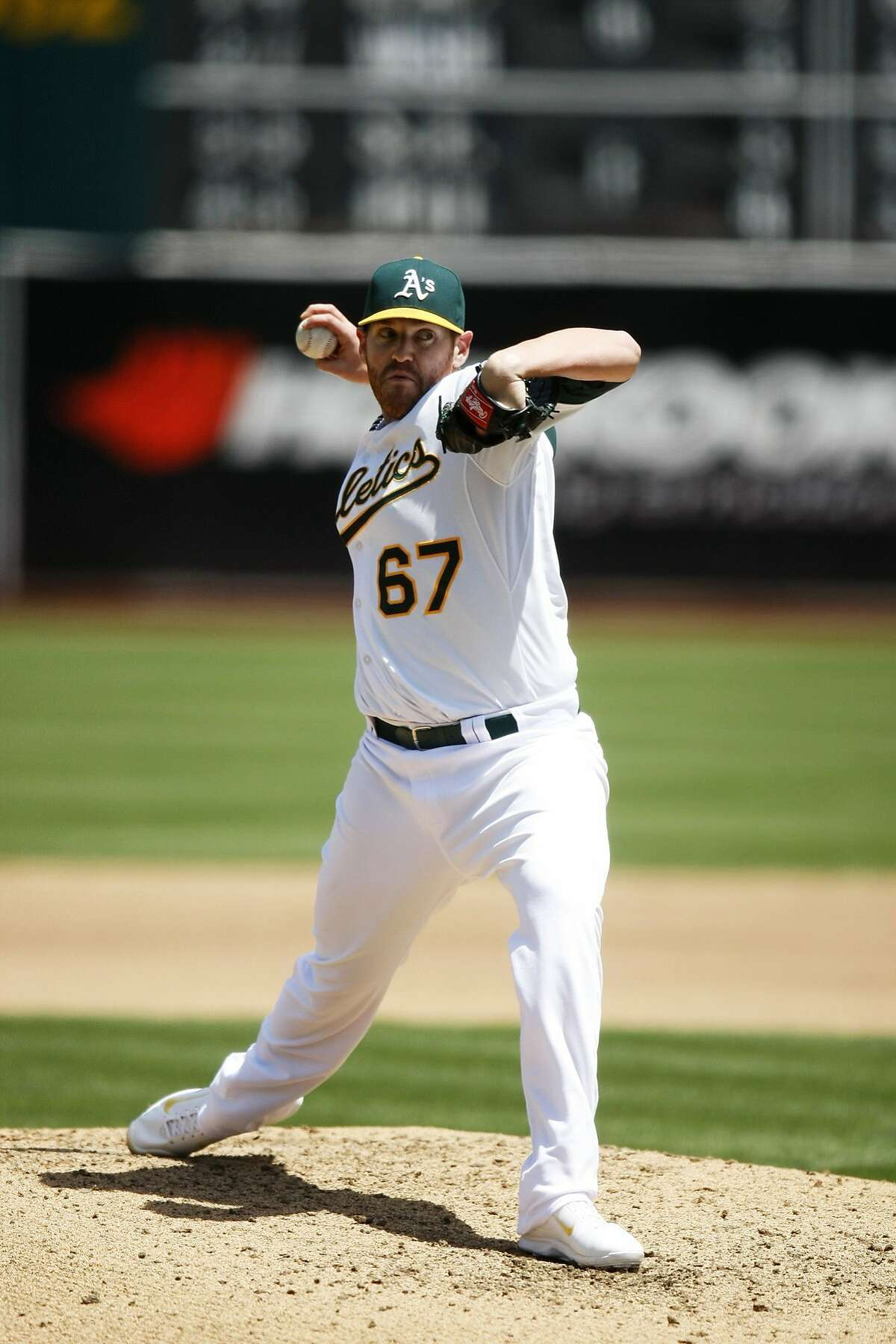 Athletics starting pitcher Dan Straily works pitches in the first inning of a game between the Oakland A's and the Seattle Mariners at O.co Coliseum on May 7, 2014 in Oakland, Calif.