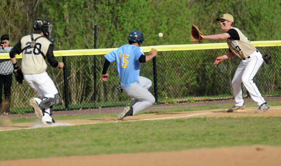 Kolbe Cathedral's Derwin Nunez is caught between third base and home plate during their game against Joel Barlow Wednesday, May 7, 2014, at Veteran's Park in Bridgeport, Conn. Photo: Autumn Driscoll / Connecticut Post