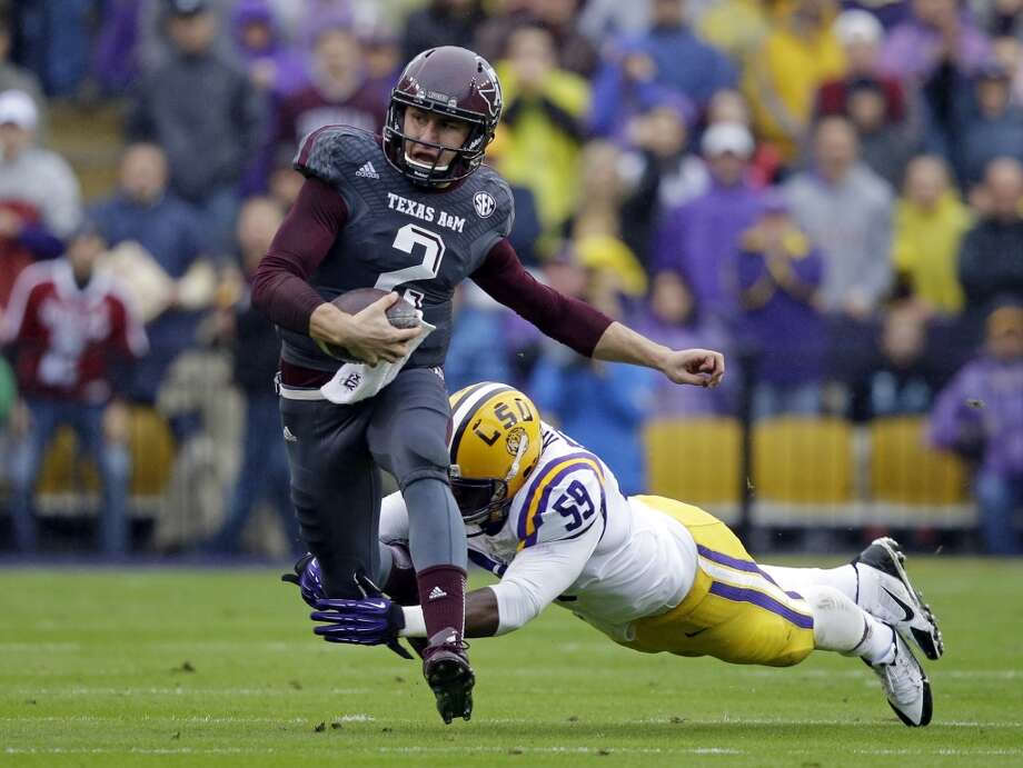4. Cleveland: Johnny Manziel, QB, Texas A&M.  He'll add instant excitement to a team and a city in need of it.  Mock 5: Manziel. Photo: Gerald Herbert, Associated Press