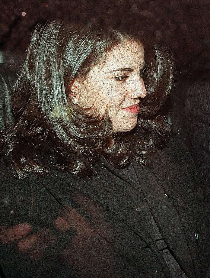This January 29, 1998 file photo shows Monica Lewinsky as she sits in the back of a car in Washington DC.  Former White House intern Monica Lewinsky broke her silence May 6, 2014 about her illicit 1990s affair with president Bill Clinton. Photo: Luke Frazza, AFP/Getty Images