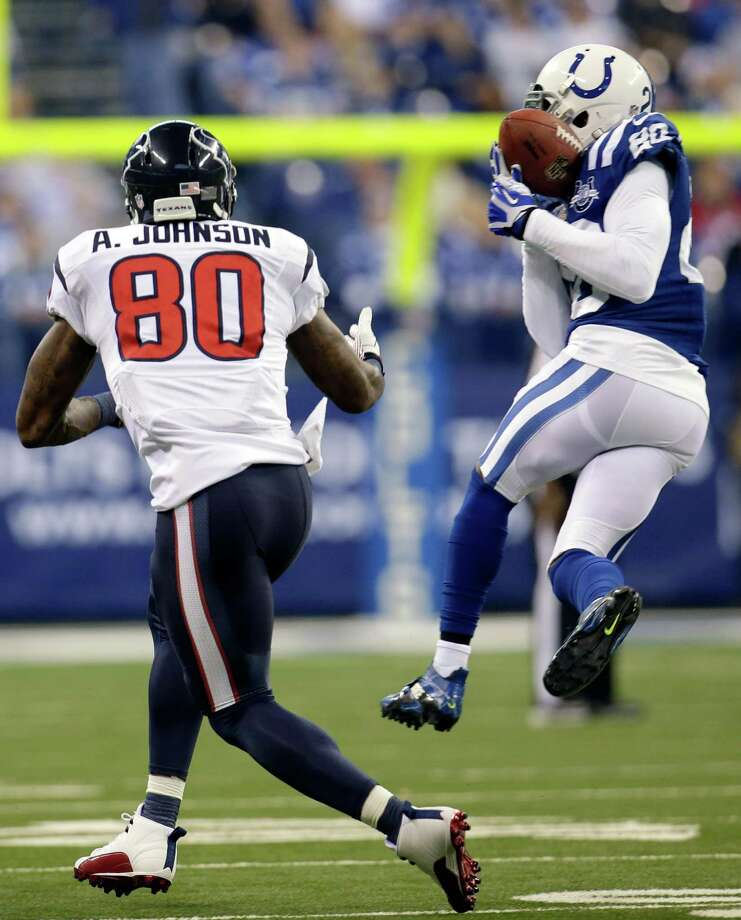 Indianapolis Colts free safety Darius Butler, right, intercepts a pass intended for Houston Texans wide receiver Andre Johnson during the first half of an NFL football game in Indianapolis, Sunday, Dec. 15, 2013. (AP Photo/AJ Mast) Photo: AJ Mast, Associated Press / Associated Press