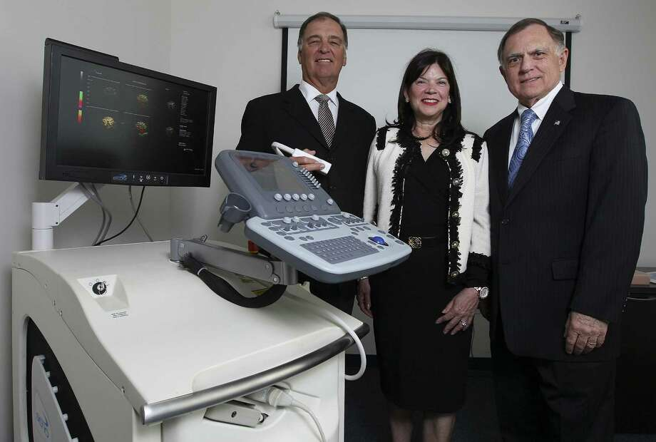 Leaders of Seno Medical Instruments — medical director Dr. A. Thomas Stavros (left), CEO and founder Janet Campbell-Clark and President Tom Miller — show the company's Imagio optoacoustic imaging system, designed to diagnose breast cancer. Photo: Kin Man Hui / San Antonio Express-News / ©2014 San Antonio Express-News