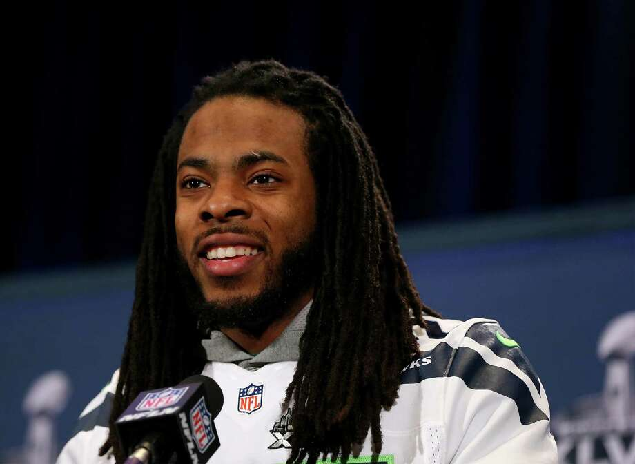 JERSEY CITY, NJ - JANUARY 30:  Richard Sherman #25 of the Seattle Seahawks addresses the media during Super Bowl XLVIII media availability at the Westin Hotel January 30, 2014 in Jersey City, New Jersey. The Denver Broncos and Seattle Seahawks will meet in Super Bowl XLVIII at Metlife Stadium on February 2, 2014.  (Photo by Elsa/Getty Images) ORG XMIT: 465303221 Photo: Elsa / 2014 Getty Images