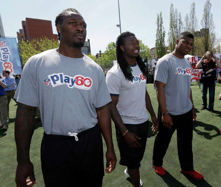 South Carolina's Jadeveon Clowney, left, Clemson's Sammy Watkins, center, and Buffalo's Khalil Mack participate in an NFL event in New York, Wednesday, May 7, 2014. The event was to promote Play 60, an NFL program which encourages kids to be active for a healthy life. (AP Photo/Seth Wenig) ORG XMIT: NYSW119 Photo: Seth Wenig / AP