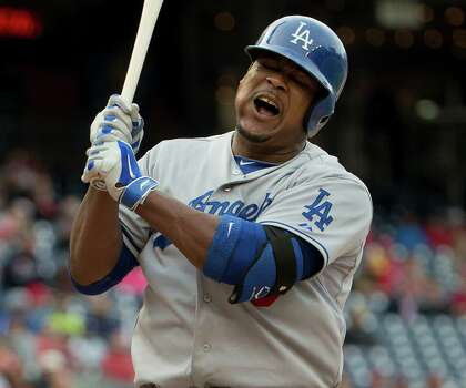 Los Angeles Dodgers Juan Uribe reacts after striking out in the ninth inning of a baseball game against the Washington Nationals Wednesday, May 7, 2014 in Washington. Nationals won 3-2. (AP Photo/Pablo Martinez Monsivais) Photo: Pablo Martinez Monsivais, Associated Press / AP