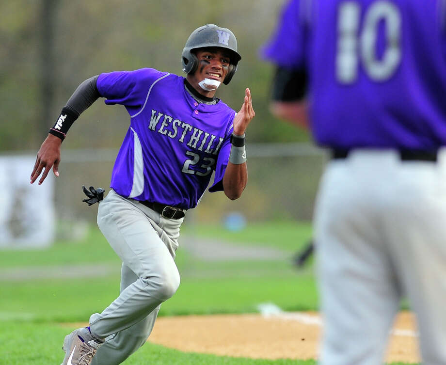 Westhill's Ronald Jackson rounds third for home plate to score , during baseball action against St. Joseph in Trumbull, Conn. on Wednesday May 7, 2014. Photo: Christian Abraham / Connecticut Post