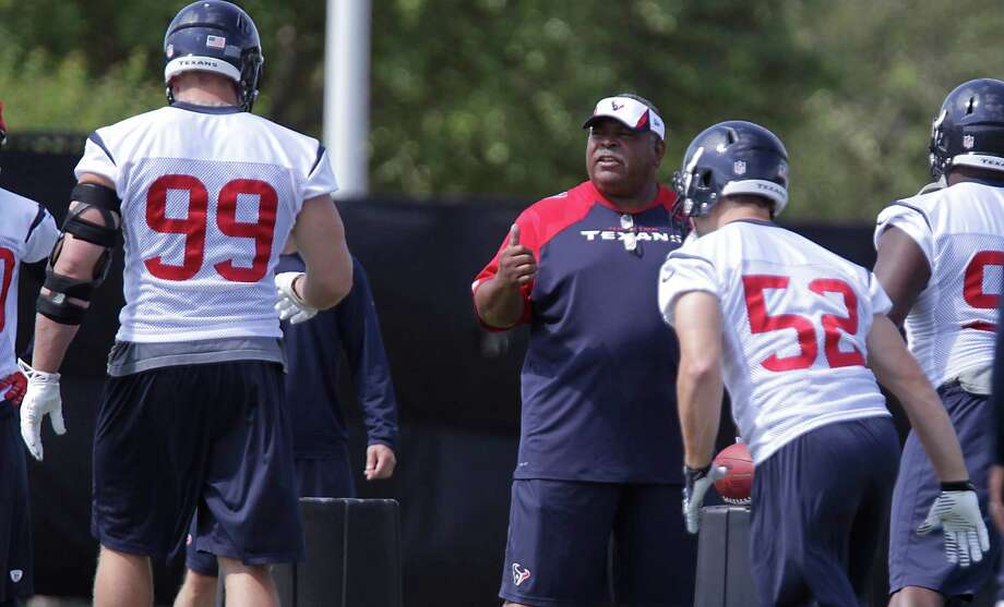 New defensive coordinator Romeo Crennel, center, will keep the Texans in a 3-4 setup, but there are many differences in the scheme from last season. Photo: James Nielsen, Staff / © 2014  Houston Chronicle
