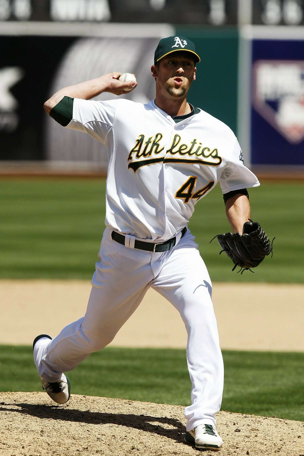 The Athletics' Luke Gregerson pitches during a game between the Oakland A's and the Seattle Mariners at O.co Coliseum on May 7, 2014 in Oakland, Calif.