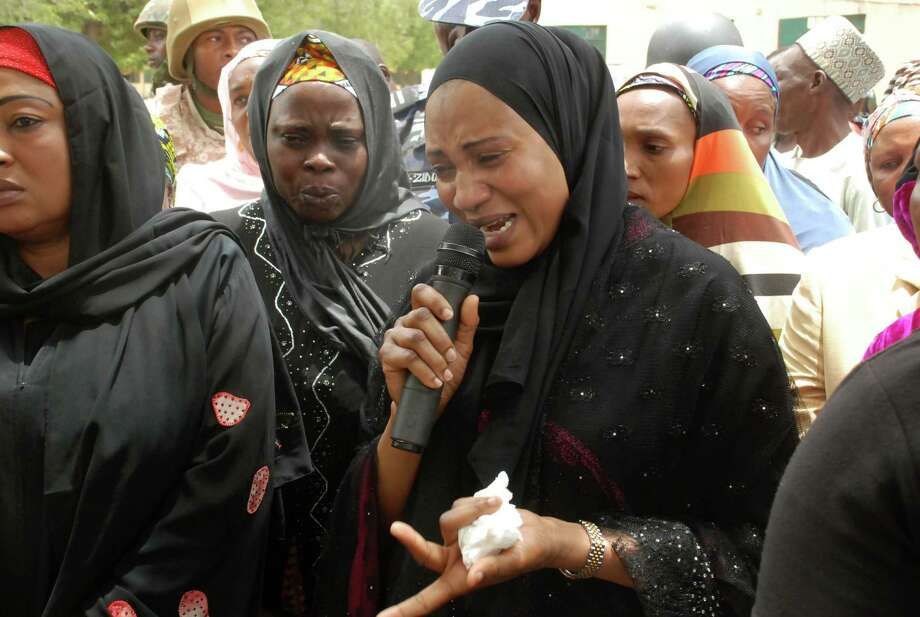 Nana Shettima, the wife of Borno Governor Kashim Shettima, speaks in anguish on Monday with school girls from the government secondary school  where students  were kidnapped by the Islamic extremist group Boko Haram. Photo: STR / AP