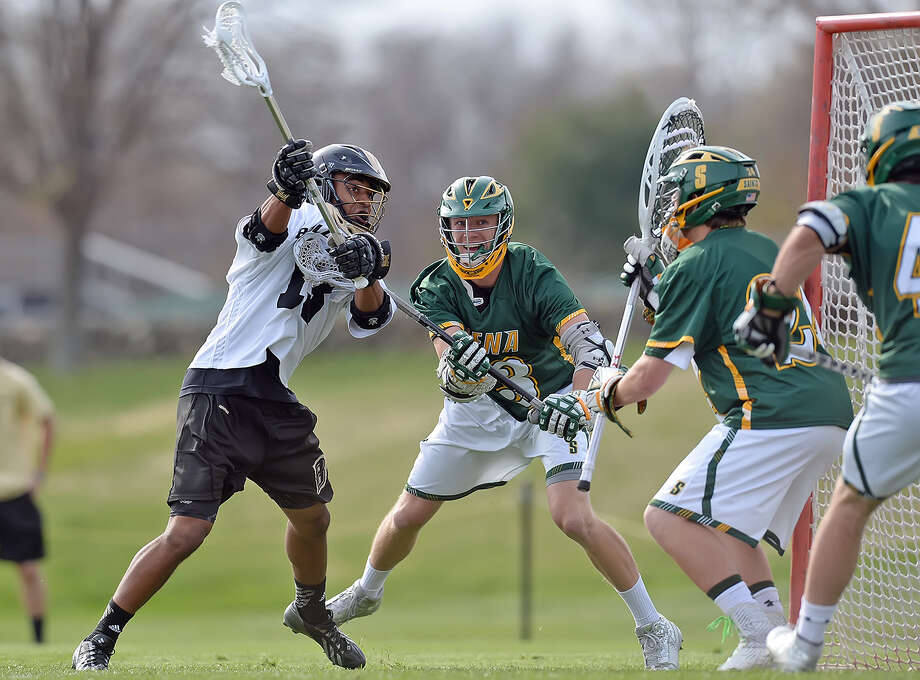 Loyola's Collins Gantz fires a shot at Siena goalie Tommy Cordts during their NCAA Tournament play-in game on Wednesday at Bryant in Smithfield, R.I. (Dave Anderson / Special to the Times Union) / DAVE ANDERSON