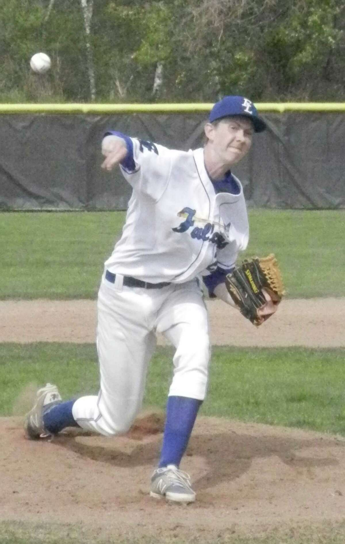 Fairfield Ludlowe senior pitcher Kevin Hickey sends a pitch to a Greenwich batter on Wednesday, May 7 in an FCIAC baseball game at Kiwanis Field. Hickey improved to 5-0 on the season in the Falcons' 3-2 win over the Cardinals.