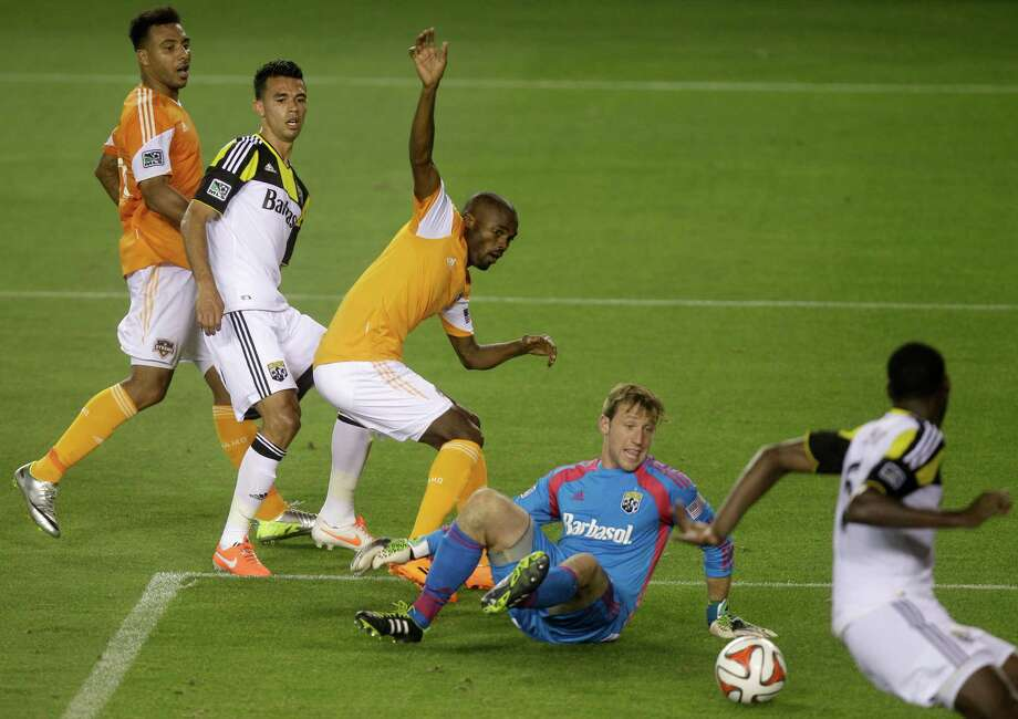 Dynamo 1, Crew 0Houston Dynamo Omar Cummings, middle, tries to get the ball by Columbus Crew goalkeeper Steve Clark, bottom, during the second half of a MLS soccer game at BBVA Compass stadium on Wednesday, May 7, 2014, in Houston. Photo: J. Patric Schneider, For The Chronicle / © 2014 Houston Chronicle