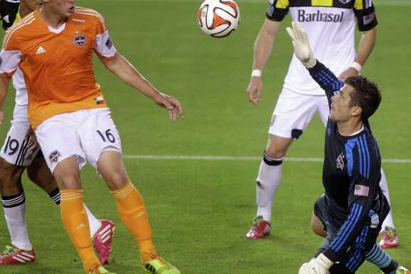 Houston Dynamo goalkeeper Tally Hall blocks a shot during the first half of a MLS soccer game against the Columbus Crew at BBVA Compass stadium on Wednesday, May 7, 2014, in Houston.