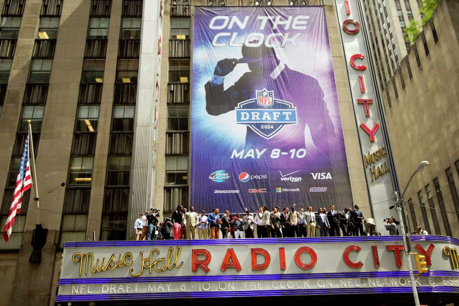 It's nearly showtime at famed Radio City Music Hall, and the stars of Thursday night's first-round drama posed atop the marquee on Wednesday. Photo: Brett Coomer, Staff / © 2014 Houston Chronicle