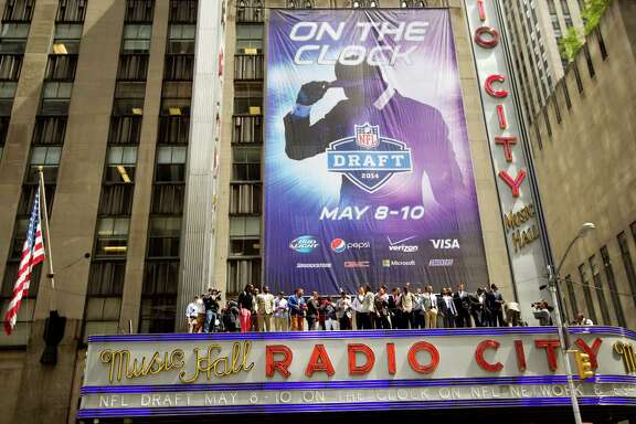 It's nearly showtime at famed Radio City Music Hall, and the stars of Thursday night's first-round drama posed atop the marquee on Wednesday.