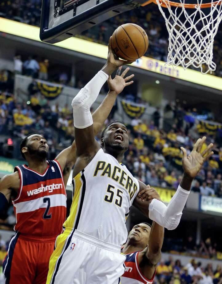 Indiana Pacers' Roy Hibbert (55) puts up a shot against Washington Wizards' John Wall (2) during the second half of game 2 of the Eastern Conference semifinal NBA basketball playoff series Wednesday, May 7, 2014, in Indianapolis. Indiana won 86-82. (AP Photo/Darron Cummings) ORG XMIT: NAF120 Photo: Darron Cummings / AP