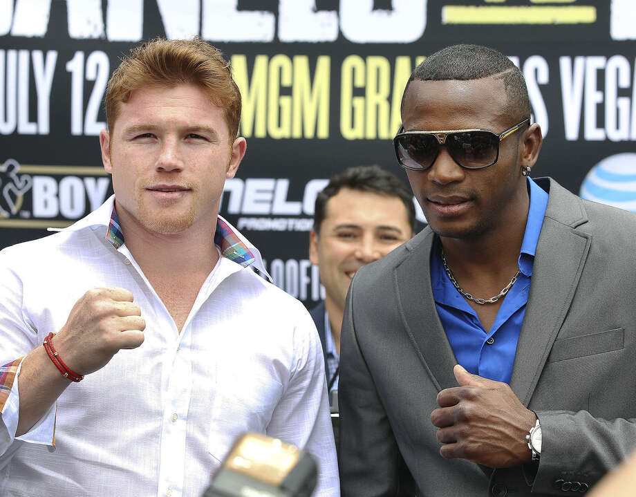 "Saul ""Canelo"" Alvarez (left) and Erislandy Lara pose for photos Wednesday at Market Square. The boxers were promoting their July 12 bout at the MGM Grand in Las Vegas. Photo: Tom Reel / San Antonio Express-News"