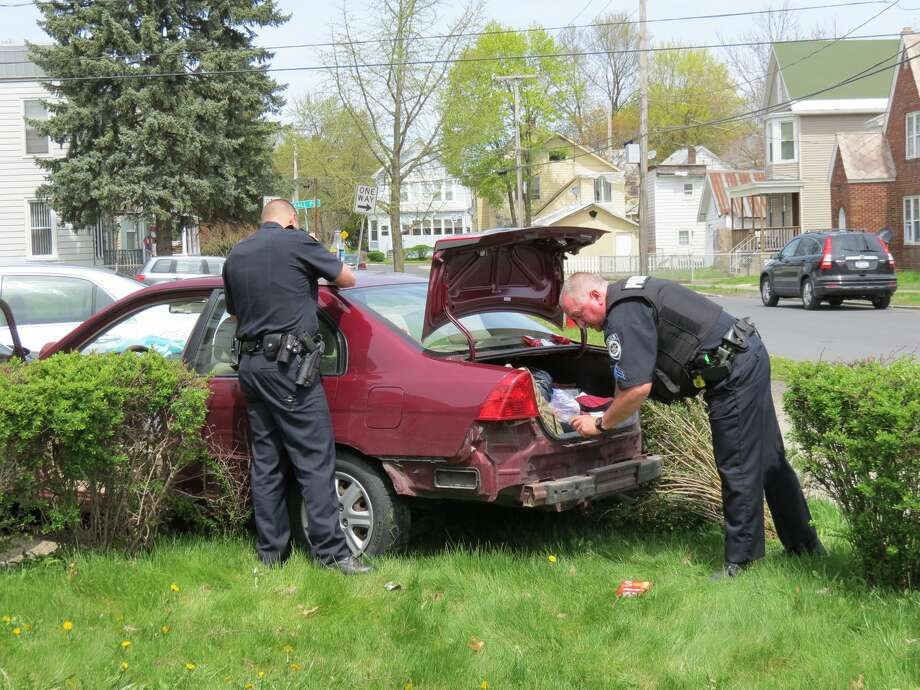 Police examine a car at the Watervliet site of a crash that followed a police chase. (Tom Heffernan Sr./Special to the Times Union) Photo: Picasa