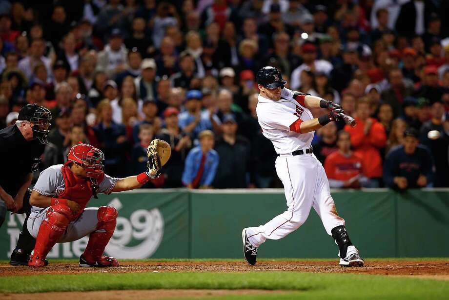BOSTON, MA - MAY 07: Will Middlebrooks #16 of the Boston Red Sox hits a go-ahead RBI single in the 8th inning against the Cincinatti Reds during the interleague game at Fenway Park on May 7, 2014 in Boston, Massachusetts.  (Photo by Jared Wickerham/Getty Images) ORG XMIT: 477582923 Photo: Jared Wickerham / 2014 Getty Images