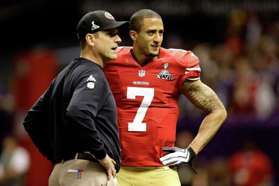 The Texans' Bill O'Brien would love to fare as well as Jim Harbaugh, left, did in his first draft with the 49ers, landing quarterback Colin Kaepernick, right, in the second round after getting defensive standout Aldon Smith with the No. 7  pick. Photo: Ezra Shaw, Staff / 2013 Getty Images