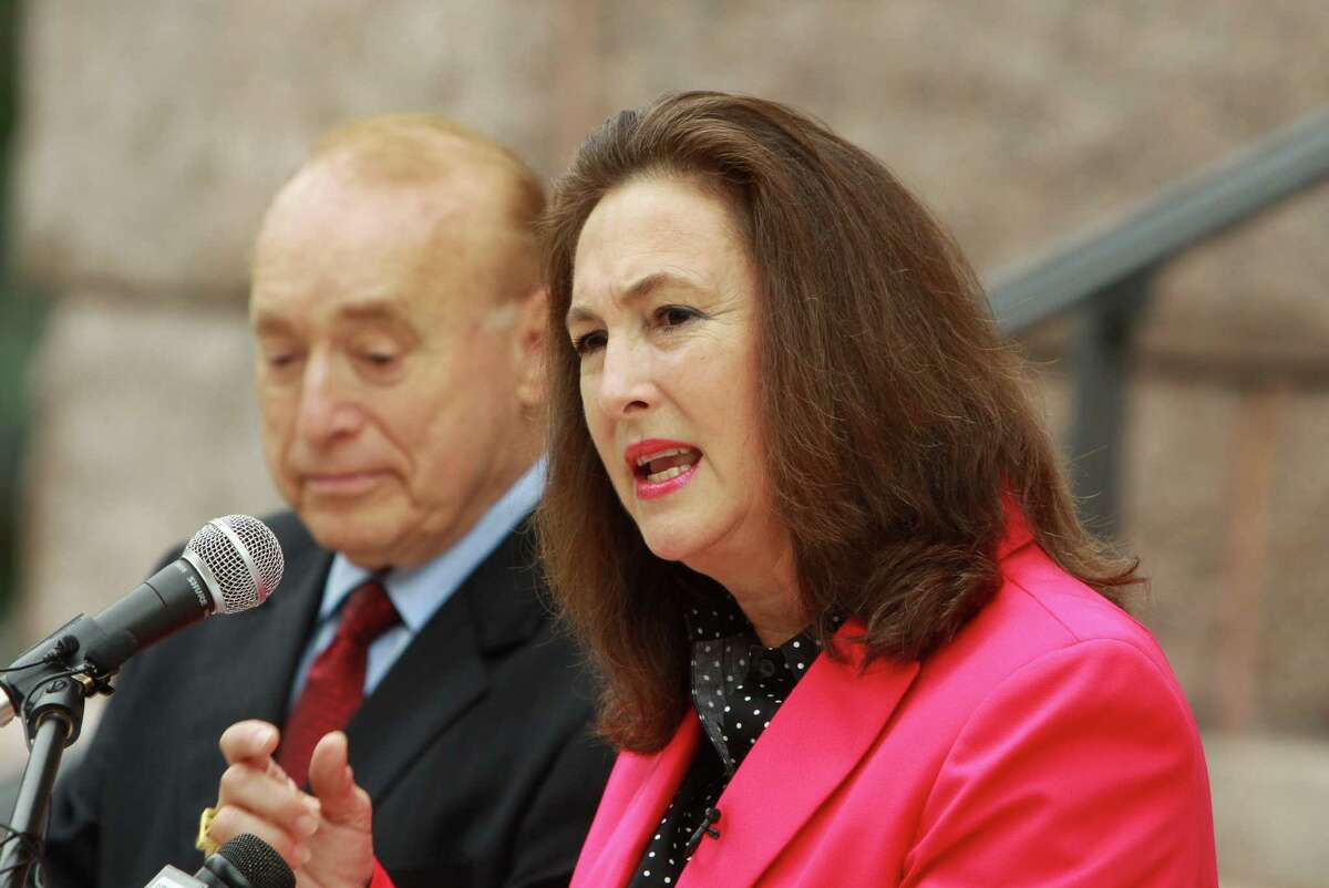 (For the Chronicle/Gary Fountain, September 30, 2013) Kim Ogg announcing her candidacy for Harris County District Attorney. In the background is her father, Jack Ogg.