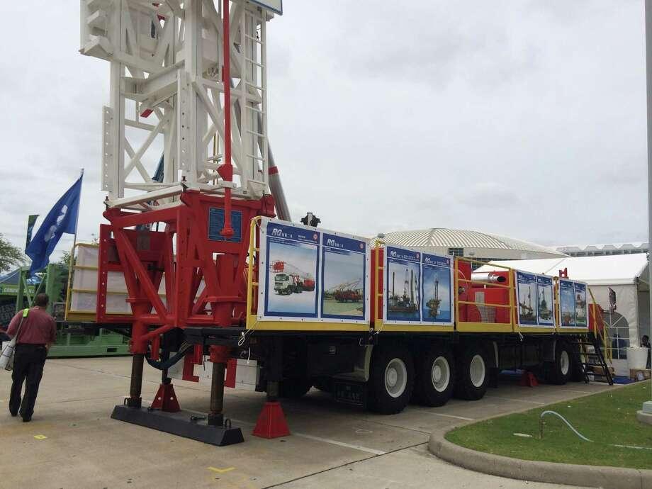 RG Petro-Machinery Group, a Chinese company, exhibits a rig suitable for doing well workovers. The company has sold 200 rigs in the U.S. since 2005. Photo: Jennifer A. Dlouhy