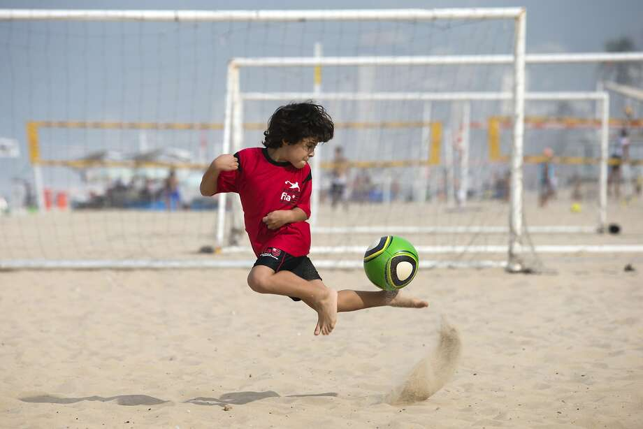 The next Pele:A boy about 4 or 5   demonstrates how he can control the ball on  Ipanema beach in Rio de Janeiro. Photo: Hassan Ammar, Associated Press