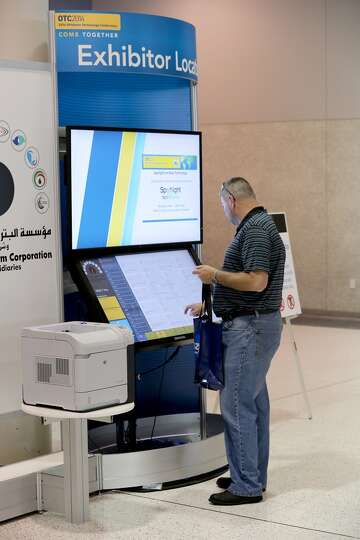 A man uses the Exhibitor Locator kiosk on day three of OTC on May 7, 2014 inside the NRG Center in H