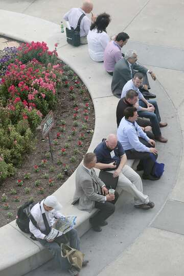 People rest outside on day three of OTC on May 7, 2014 inside the NRG Center in Houston, TX. (Photo:
