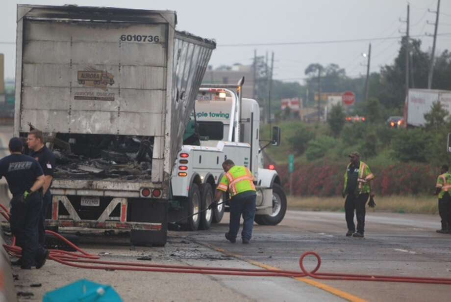 A fiery semi wreck about 3:30 a.m. had all lanes of Interstate 10 in both directions shut for hours with cleanup efforts near Cedar Lane. Photo: Cody Duty / Houston Chronicle