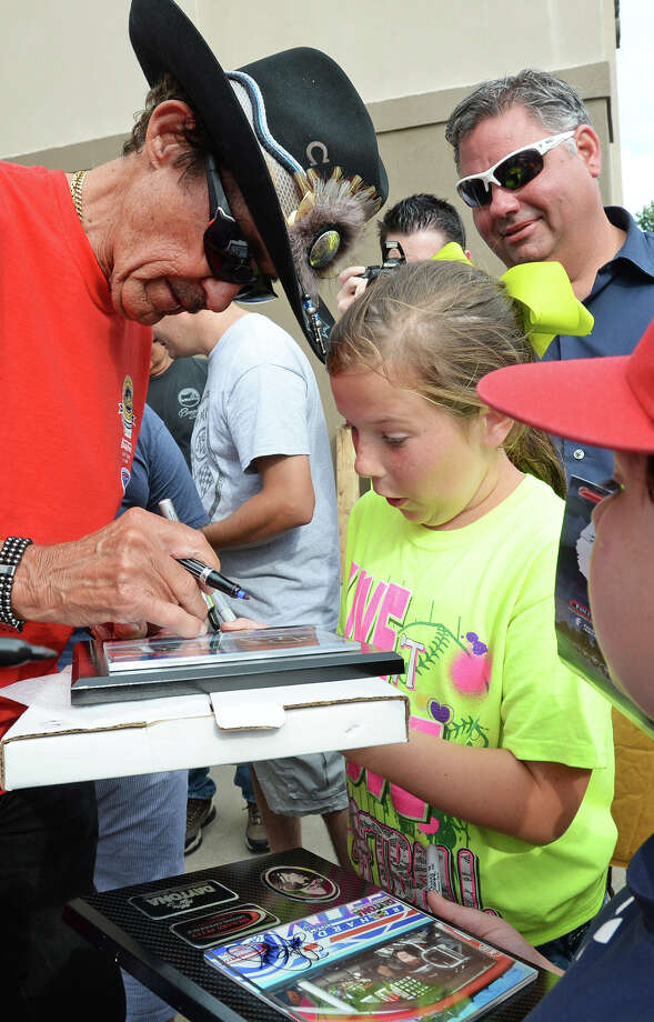 Legendary NASCAR driver Richard Petty signs an autograph Wednesday for Kayleigh Ritchey, 11 during a Beaumont pitstop for the Kyle Petty Charity Ride Across America. Riding with around 200 other motorcyclists, Kyle Petty raises money for Victory Junction and other children's charities. Photo taken Wednesday, May 07, 2014 Guiseppe Barranco/@spotnewsshooter Photo: Guiseppe Barranco, Photo Editor