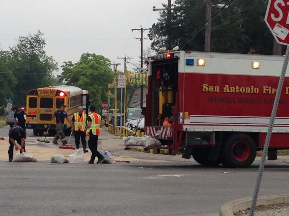 A car and a school bus were involved in a crash Thursday morning northwest of downtown. Photo: Alia Malik/San Antonio Express-News