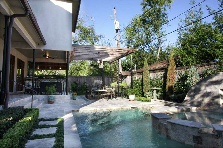 Designer Dena Brody expanded the porch area to fit an outdoor kitchen, living and dining space--plus a pool--in this compact Bellaire backyard. / ONLINE_YES