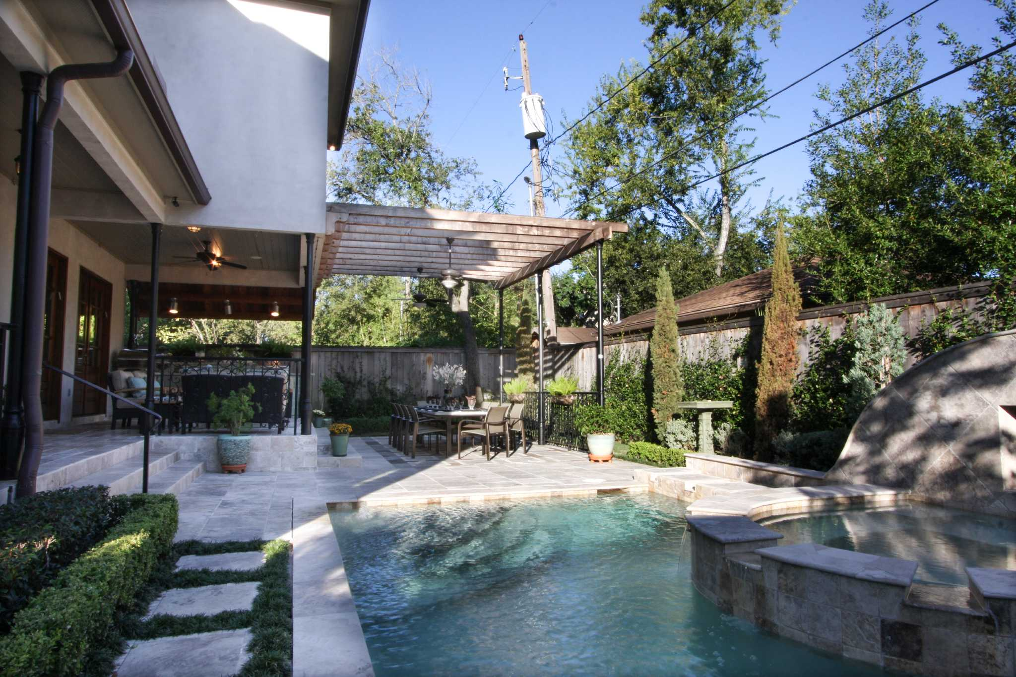 a blissful backyard in bellaire inspired by jewish tradition
