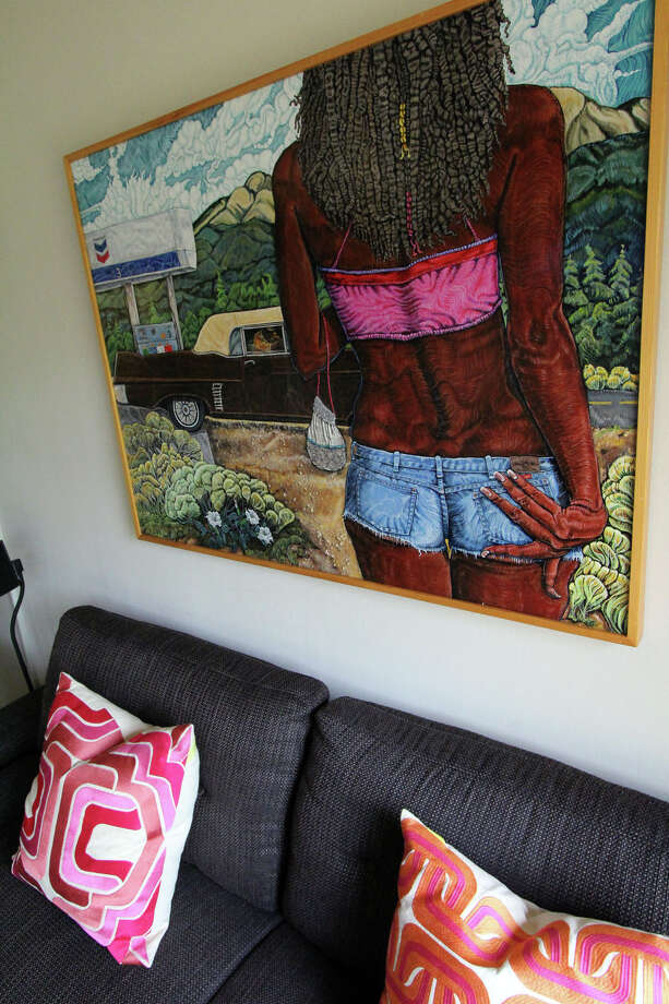 Above the sofa in the den, ÒNadine,Ó a painting by New Mexico artist Henry Berger depicts the lyrics from the Chuck Berry Song about Nadine walking toward a coffee-colored Cadillac. It's in the home of Marlon Quinones and Hagan Retzloff. Photo: DANNY WARNER, For The Express-News / ALL RIGHTS RESERVED UNLESS OTHERWISE SPECIFIED