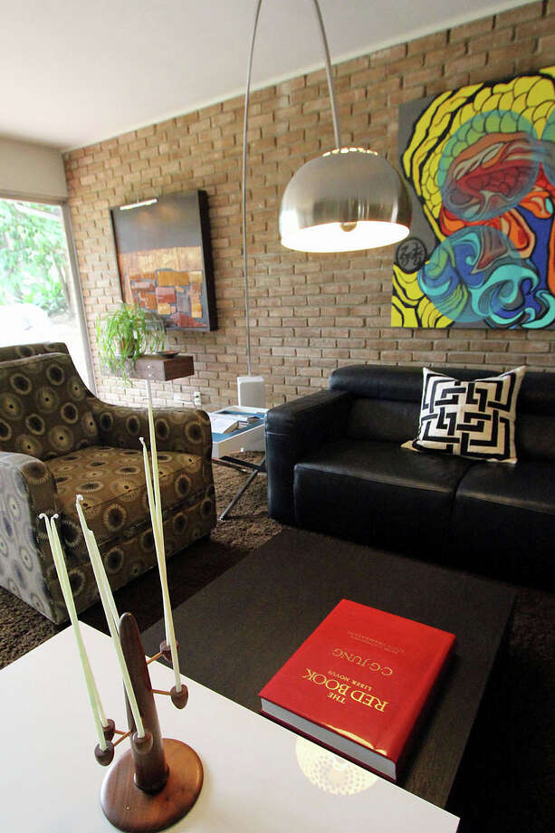Marlon Quinones and Hagan Retzloff moved from downtown to Inspiration Hills. In the living room the Arco lamp and black leather sofa came from Copenhagen; the black and white table was bought at Nest. Photo: DANNY WARNER, For The Express-News / ALL RIGHTS RESERVED UNLESS OTHERWISE SPECIFIED