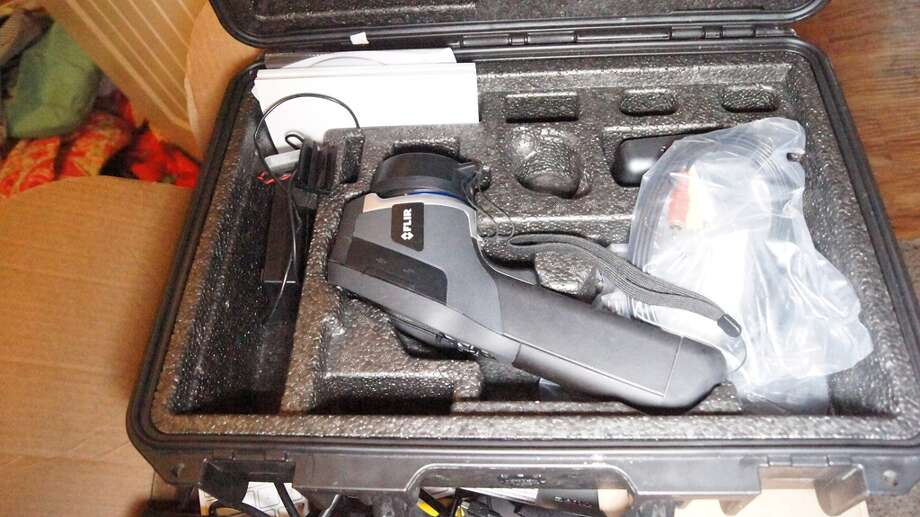 The frame of a stolen pistol with a loaded magazine was also recovered from the living room. Photo: Scott Engle / Montgomery County Police Reporter
