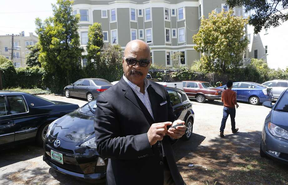 Preston Turner, chairman of the board at Third Baptist Church in San Francisco, works with the SpotOn app  to rent out the church's overflow parking area when it's not needed for services or other events. Photo: Michael Macor, The Chronicle