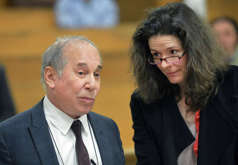 Singer Paul Simon, left, and his wife Edie Brickell appear at a hearing in Norwalk Superior Court on