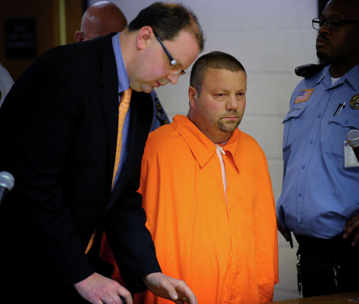 Scott Gellatly stands quietly before the judge during his arraignment for Wednesday's Oxford murder of his estranged wife, Lori Gellatly, in Superior court in Derby, Conn. on Thursday, May 8, 2014.