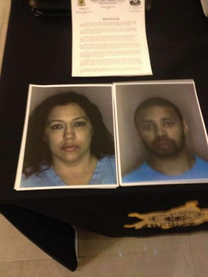 Mugshots of Suzanne Guzman-Moore and her boyfriend, Emmett Woods, were taken into custody after Albany County authorities said they linked them to the theft of patient information at Albany Medical Center Hospital where Guzman-Moore was a nurse. (Bryan Fitzgerald / Times Union)