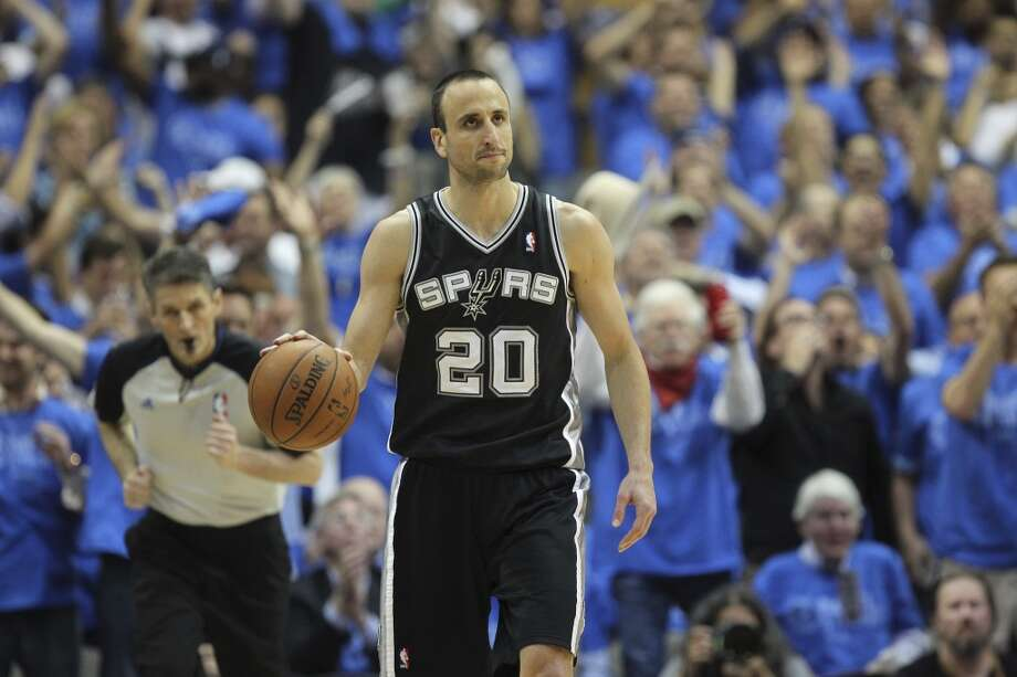 San Antonio Spurs' Manu Ginobili brings the ball up the court during the second half of game four in the first round of the Western Conference Playoffs against the Dallas Mavericks at the American Airlines Center in Dallas, Monday, April 28, 2014. The Spurs won 93-89 to tie the series 2-2. Photo: Jerry Lara, San Antonio Express-News
