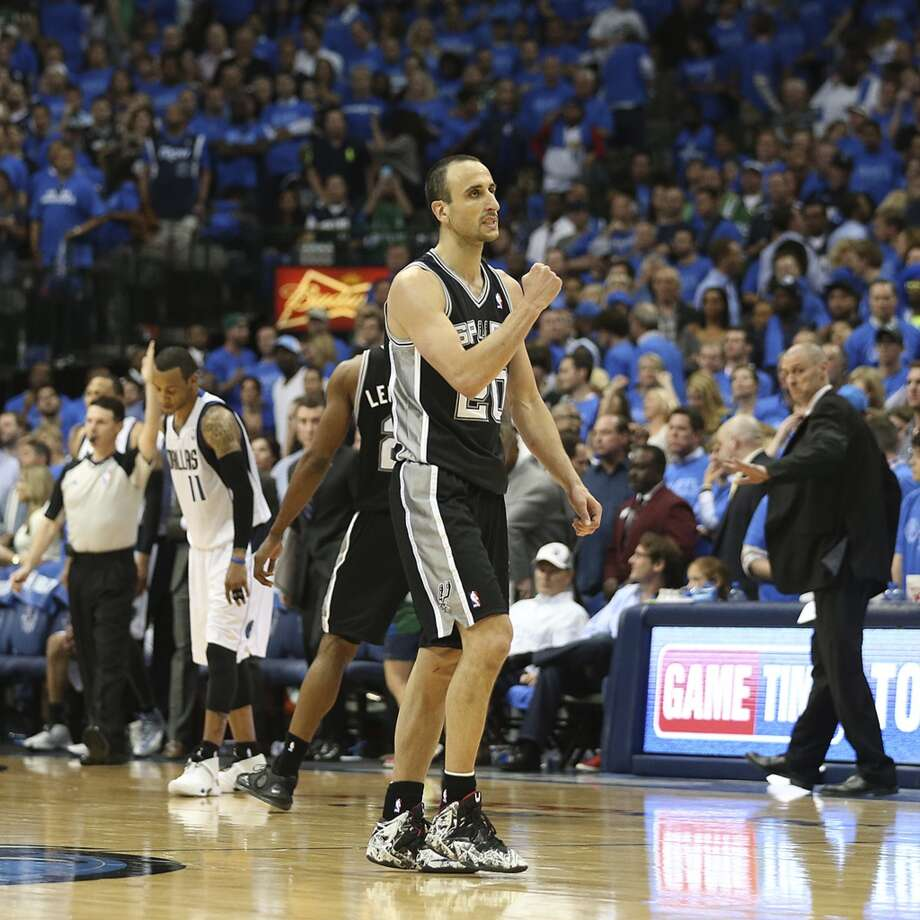 San Antonio Spurs' Manu Ginobili reacts at the end of the game after hitting his two foul shots in of game four in the first round of the Western Conference Playoffs against the Dallas Mavericks at the American Airlines Center in Dallas, Monday, April 28, 2014. The Spurs won 93-89 to tie the series 2-2. Photo: Jerry Lara, San Antonio Express-News