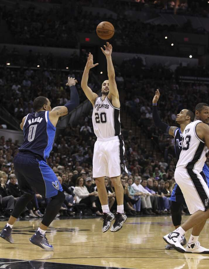 Spurs' Manu Ginobili (20) shoots a three-pointer over Dallas Mavericks' Shawn Marion (00) in the second half of Game 2 of the first round of the Western Conference playoffs at the AT&T Center on Wednesday, Apr. 23, 2014. Mavs defeated the Spurs, 113-92. (Kin Man Hui/San Antonio Express-News) Photo: Kin Man Hui, San Antonio Express-News