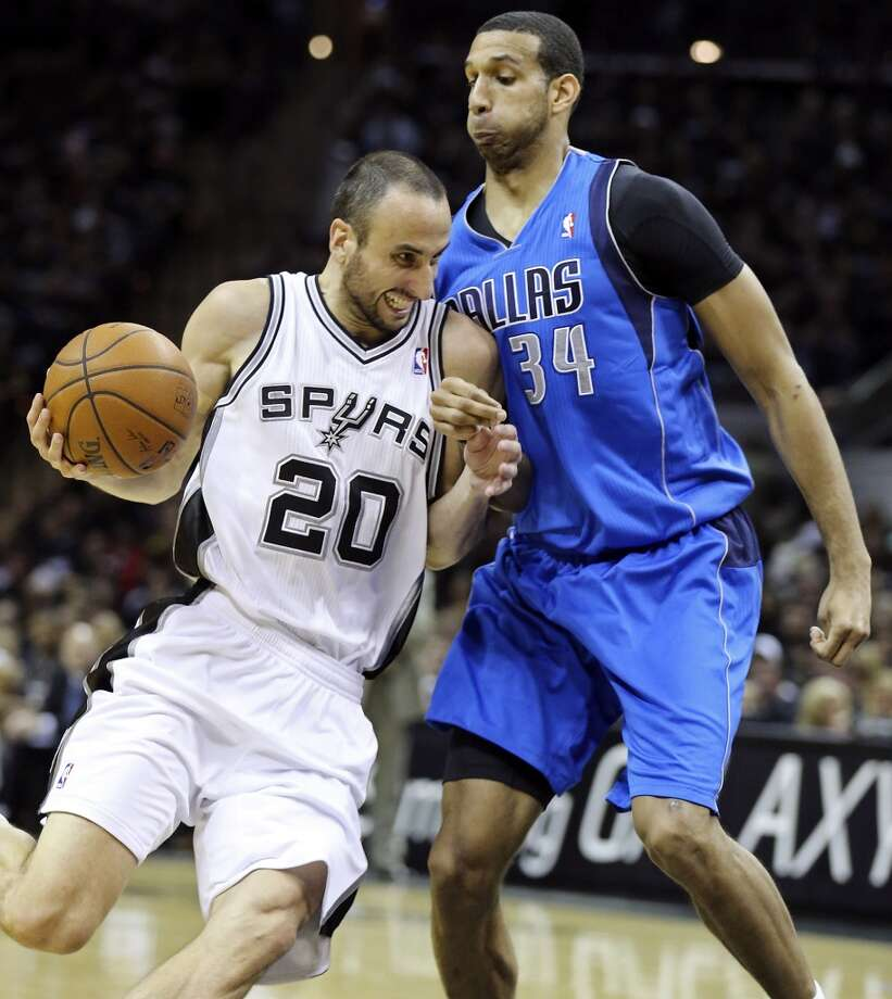 San Antonio Spurs' Manu Ginobili looks for room around Dallas Mavericks' Brandan Wright during second half action of Game 1 in the first round of the Western Conference playoffs Sunday April 20, 2014 at the AT&T Center. The Spurs won 90-85. Photo: Edward A. Ornelas, San Antonio Express-News