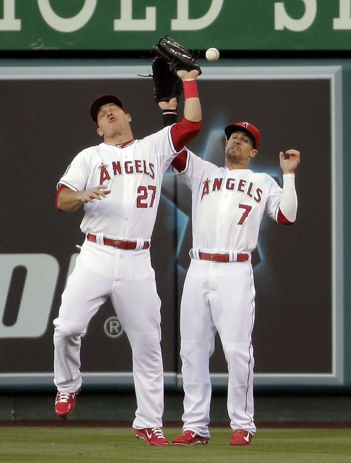 It's easier to catch with your eyes open, boys: Los Angeles Angels center fielder Mike 