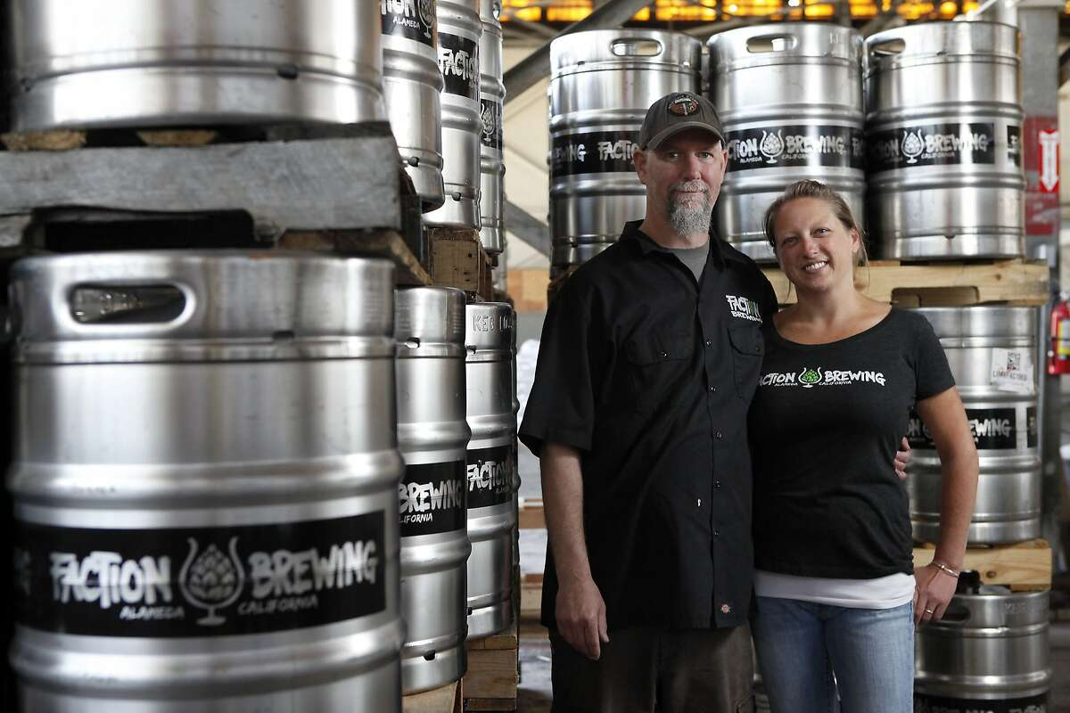 Husband and wife team and owners, Rodger Davis and Claudia Pamparana pose for a portrait at Faction Brewing Company in Alameda, CA, Wednesday May 7, 2014.