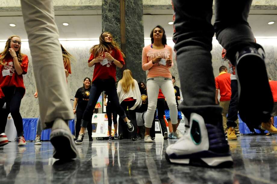 Youths from New York City YMCA clubs demonstrate an exercise routine during at the Healthy Kids Day Advocacy Event on Wednesday, May 7, 2014, at the Legislative Office Building in Albany, N.Y. (Cindy Schultz / Times Union) Photo: Albany Times Union