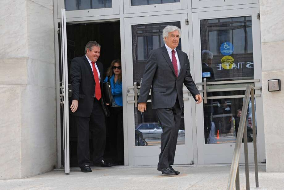 Former state Senate Majority Leader Joseph Bruno leaves the James T. Foley U.S. Courthouse during a lunch break from the resumption of his corruption trial with son Kenneth Bruno, left,  on Wednesday, May 7, 2014 in Albany, N.Y.  (Lori Van Buren / Times Union) Photo: Albany Times Union