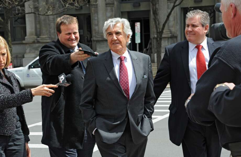 Former state Senate Majority Leader Joseph Bruno is surrounded by media as he leaves the James T. Foley U.S. Courthouse during a lunch break from the resumption of his corruption trial on Wednesday, May 7, 2014 in Albany, N.Y.  He is accompanied by his son Kenneth Bruno, right. (Lori Van Buren / Times Union) Photo: Albany Times Union